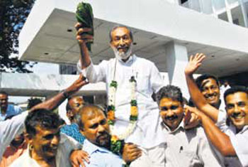 The picture shows Vasudeva Nanayakkara, decorated with a garland, who petitioned against the privatisation of the Sri Lanka Insurance Corporation (SLIC) being carried out of the Supreme Court Premises by a jubilant group of former SLIC employees[Image Credit:http://www.nation.lk/2009/06/07/busi1.htm]