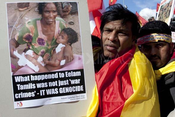 1331229537-thousands-of-tamils-protest-outside-the-un-geneva_1094661
