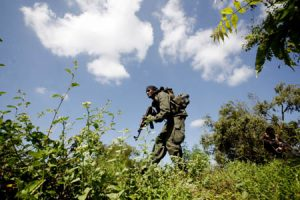 A Sri Lankan army soldier takes part in an operation to regain territory from the Tamil rebels in Jaffna