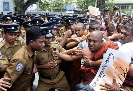 "Demonstrators from the ""Power of Ravana"" organization clash with police officers during a protest against the visit by U.N. High Commissioner for Human Rights Pillay, in Colombo"