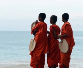 TOPSHOTS  Young Sri Lankan Buddhist monks look on from the beach at Peraliya village in southern Sri Lanka on December 26, 2012, on the eighth anniversary of the Asian tsunami. Some 31,000 people on the island died during the 2004 Asian tsunami and one million were initially left homeless. AFP PHOTO/ LAKRUWAN WANNIARACHCHILAKRUWAN WANNIARACHCHI/AFP/Getty Images ORG XMIT: