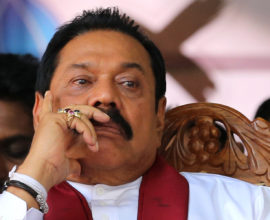 KANDY, SRI LANKA- AUGUST 14 : Former Sri Lankan president and parliamentary candidate Mahinda Rajapaksa attends his party's final day of election campaign rally on August 14, 2015 in Kandy, Sri Lanka. Sri Lanka's Election Commission has scheduled the polls on August 17, 2015, after Sri Lankan President Maithripala Sirisena dissolved the parliament on June 26, 2015.  (Photo by Buddhika Weerasinghe/Getty Images)
