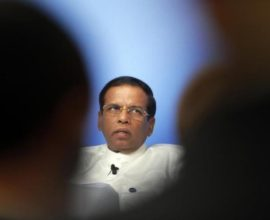 Sri Lanka President Maithripala Sirisena speaks on the podium during a panel discussion at the Anti-Corruption Summit in London, Thursday, May 12, 2016